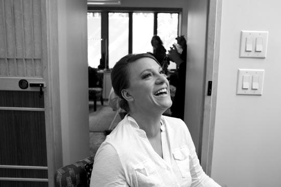 Brie laughs while having her makeup done on the morning of her wedding — Scott Kingsley/Kingsley Images