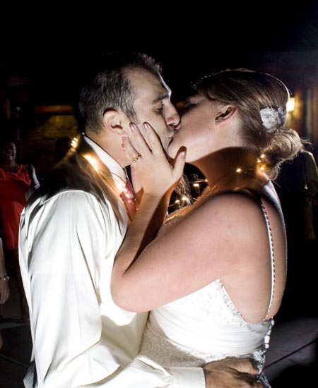 Brie & Arturo kiss during the final moments of their reception — Scott Kingsley/Kingsley Images
